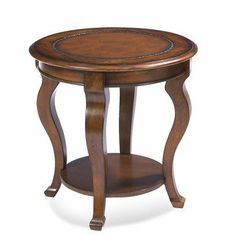Pontevecchio End Table by Bassett Mirror. $297.09. Round Shape. Mahogany Finish. Traditional Style. Belongs to Pontevecchio Collection by Bassett Mirror Company. Hardwood construction with tooled leather inlay tops and faces. 8125-220 Features: -End table.-Round shape.-Lower shelf for additional storage.-Cameo shaped legs. Construction: -Hardwood construction. Color/Finish: -Mahogany finish.-Hand tooled genuine leather top insert with an antiqued stain resistant finish. Assembly...