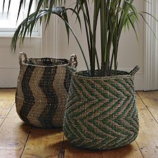 Baskets: a way to use cheap plastic pots and still look good.