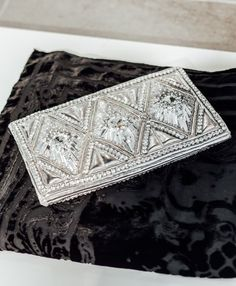 H&M x Balmain Beaded Clutch // Exclusive: See 40+ of the Most Detailed Balmain x H&M Photos Yet: (http://www.racked.com/2015/10/23/9602912/hm-balmain-review-photos#4862765)