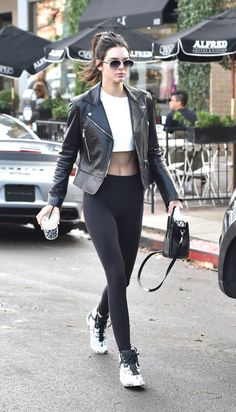 An athleisure style icon in her own right, the supermodel looks to a single transition piece when moving from the gym to lunch: a leather biker jacket. Throwing it on with her workout uniform comprised of a crop top, leggings, and trainers, it styles up the look without feeling too polished.   - MarieClaire.com