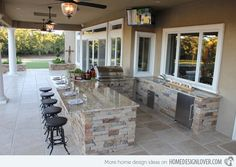 This would be my exact outdoor kitchen underneath my house open (but screened  in) to the lake   For security while away-use doors accordion outdoor doors.