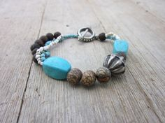 Turquoises and Natural Seeds Bracelet by eltallerdelaviajera, $18.00