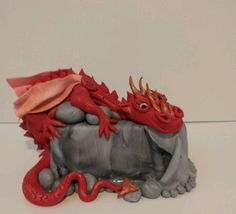 lord of the rings game of thrones any dragon really! dragon cake can be made in different colours and designs.....shooga.com.au