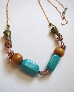 Wire, wood and vintage bead rustic boho style necklace. On copper bar chain with lobster claw clasp.  By Emerald City Custom Jewelry.