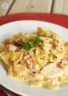 Copycat Johnny Carino's Bowtie Festival - Al dente bowtie pasta tossed with bacon, tomatoes, onions, and a creamy sauce. This is a Johnny Carino's copycat favorite!