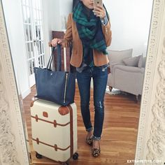 Casual + comfortable travel outfit - skinny jeans, neutral blazer, plaid blanket scarf, navy tote, carry on luggage, leopard flats