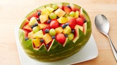 Get creative with fruit salad. Serve your family with this watermelon bowl filled with variety of fruits – ready in 45 minutes. Watermelon Bowl, Watermelon Carving, Carved Watermelon, Watermelon Margarita, Fruit Salad With Pudding, Fruit Salad Recipes, Fruit Salads, Graduation Party Foods, Graduation Ideas
