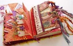 An excellent way showcase your different mixed media projects and textile pieces. Check out this tag journal with stitched collaged cover by Craftsontheweb at Cloth Paper Scissors.