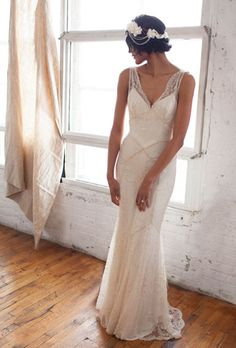 """This Great Gatsby-esque design, """"Gemma"""" by Brooklyn's Rebecca Schoneveld, utilizes cross-beading and lace to create a flawless form-fitting ..."""