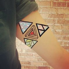 Best Geometric Tattoo Minimal Geometric Tattoos Brought To Life - Minimal geometric tattoos brought to life with bursts of colour