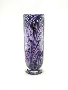 Deep hues of hyacinth purple and lilac with bold black feather pattern. Made by my partner, Jim, at our hot glass studio in Paradise, CA, USA. Hot applied clear glass base ensures stability. Perfect for flowers & bouquets. Signed James Moody Dated 2012  Dimensions - (appx.) 11 1/8 tall, 3 3/4 opening, & 3 5/8 base    Keep away from heat and direct sunlight (i.e. temperature shock; extreme temperature changes)    You will receive the one-of-a-kind work pictured above, no...