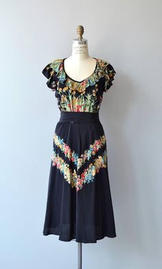 Vintage 1970s black rayon dress with floral bodice and floral banded skirt, wide ruffled neckline, elastic waist, matching self-fabric belt and swishy skirt. --- M E A S U R E M E N T S --- fits like: best fits small bust: 33-36 waist: 24-28 hip: 37 length: 44 brand/maker: n/a condition: excellent to ensure a good fit, please read the sizing guide: http://www.etsy.com/shop/DearGolden/policy ✩ layaway is available for this item ✩ more vintage dresses ✩ ht...