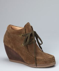 Put a wedge between comfort and style. Sleek suede with lace-up closures ties up the rest of the wardrobe.