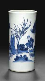 A SMALL BLUE AND WHITE BRUSH POT TRANSITIONAL PERIOD, CIRCA 1635-1640 The sides are painted with a continuous scene of a scholar standing beside a tree in a garden, as an attendant carrying a wrapped bundle approaches, all between incised double-line borders at the rims. 6½ in. (16.7 cm.) high