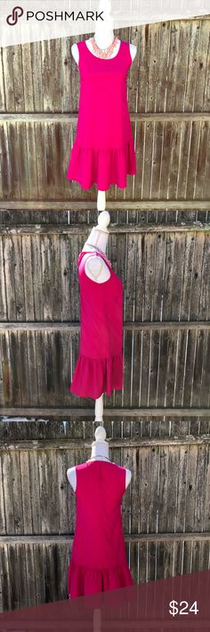 UNIQLO sleevess dress with ruffle hem Casual dress by Uniqlo in bright pink. Rayon/Polyester. Round neck, keyhole back with button closure and flirty ruffle hem! Great preowned condition. Size XS but designed for a loose, flowy fit. Uniqlo Dresses Mini