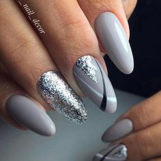 Silver gray nails with black and white detailing. Silver glitter accent nail. Beautiful nails for Christmas or the holidays. #nails #nailart