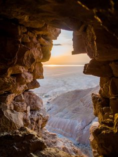 Sunrise over the Judean Desert as viewed from a cavern entrance in Masada, Israel.