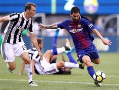 Lionel Messi #10 of Barcelona takes the ball as Stephan Lichtsteiner #26 of Juventus defends during the International Champions Cup 2017  on July 22, 2017 at MetLife Stadium in East Rutherford, New Jersey.