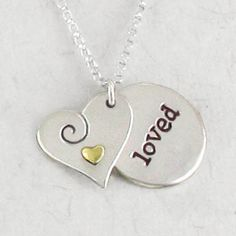 Sterling silver heart shaped pendant with spiral and brass heart rests on sterling silver circle pendant inscribed with the word loved. Mother Jewelry, Jewelry Quotes, Engraved Jewelry, Love Symbols, Birthstone Jewelry, Love Heart, Artisan Jewelry, Dog Tag Necklace, Heart Shapes