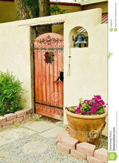 Photo about A decorative entrance with ornate gate and bell to a Spanish-style walled courtyard in New Mexico. Image of gateway, external, entry - 21803156 Spanish Bungalow, Spanish Style Homes, Spanish Revival, Spanish House, Spanish Colonial, Spanish Courtyard, Courtyard Entry, Courtyard Ideas, Front Gates