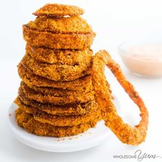 These baked low carb onion rings are crispy, gluten-free, healthy, and just begging to be dunked into some spicy dipping sauce.