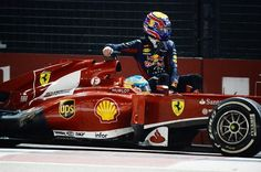 Screw the stewards! Fernando Alonso (ESP) Ferrari gives Mark Webber (AUS) Red Bull Racing a lift home. Formula One World Championship, Singapore Gran. Singapore Grand Prix, Mark Webber, Gilles Villeneuve, Red Bull Racing, Ferrari F1, F1 Drivers, Indy Cars, Car And Driver, Formula One