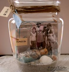 Sand, shells, and a picture from your beach trip in a jar.