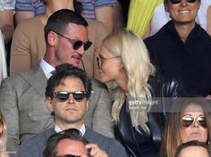 Luke Evans and Poppy Delevingne attend the Men's Final of the Wimbledon Tennis Championships between Milos Raonic and Andy Murray at Wimbledon on July 10, 2016 in London, England.