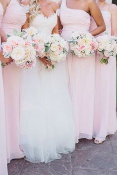 Mixing white and pink flowers so that everyone's flowers can be the same but will still match bridesmaids vs bride.