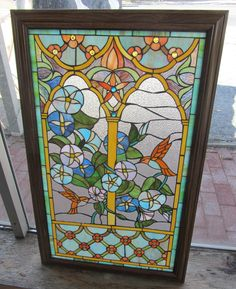 20th C. Stained glass window with hummingbirds 37  1/2 x 23 Auction Estimate 200-400