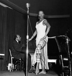 Maya Angelou performs at New York's Village Vanguard, accompanied by Clarence Williams. c. 1960
