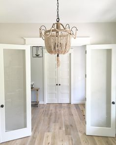 color in the first room is Pale Oak by Benjamin Moore. The color that's further away is Gray Owl