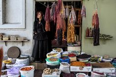 A shopowner sells dried fruits and nuts at the Dezertiri Market in Tbilisi, Georgia. Credit David Hagerman