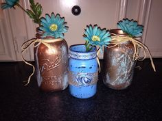 PRICE---($20)- SET OF 3 JARS  Home Decor, Mason Jar Storage & Organization/ Vase   Beautiful, set of three, mason jars in vintage. There are two quart sized mason jars and one pint size mason jar. The turquoise, pint sized mason jar, has beautiful silver/turquoise trim around the month of the jar. This jar also has a handmade, ribbon trim, rose accenting it. . The other two jars are vintage mason jars painted in copper primer and paint, then accented with blue patina.