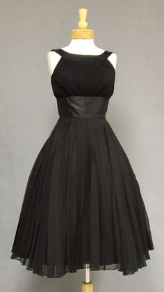 black 1950's halter dress. In love with this. Reminds me of Audrey Hepburn in Breakfast at Tiffany's.