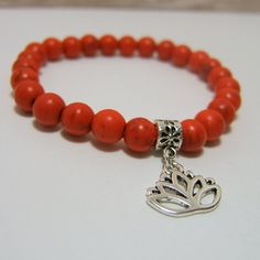 Red Orange Magnesite BRACELET ~ Flower Petal Bail Bead with Lotus Flower charm ~ 8mm beads on stretch cord - measures approx 7 inches www.sgtpepperscreations.etsy.com #gemstonebracelet #orange #magnesite #lotusflower
