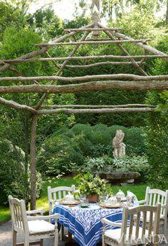 Lunch in the garden, under a canopy of locust......Rose Garden Redo - Veranda.com  Charlotte Moss's East Hampton Garden.