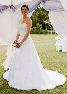 Satin and organza A-line with side-draped bodice and beaded Pink metallic embroidery.   Chapel train.