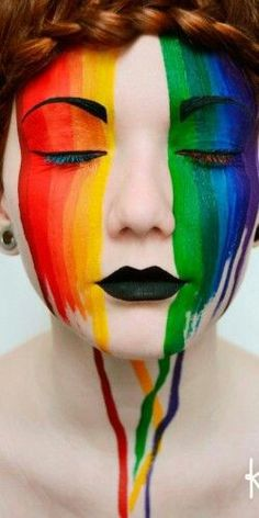 Rainbow paint dripping with black lips and brows