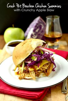 Crock Pot Bourbon Chicken Sammies with Crunchy Apple Slaw is a unique and mouthwatering crock pot recipe. | iowagirleats.com