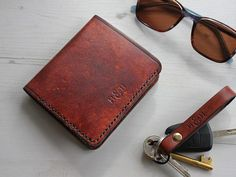 Brown leather bi-fold wallet from Hide & Home, passionately handmade in England. These slim card wallets for men can be personalised, making it a perfect gift for him.