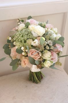 Bouquet of quicksand roses, miss bombastic roses, snowberries, astrantia, ammi and eucalyptus. Liberty Blooms