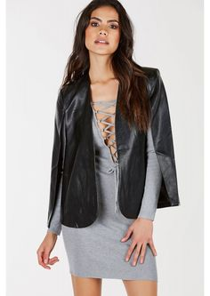 A statement faux leather blazer with a stylish cape design. Smooth lining for comfort and pockets...