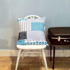 Scandi cushion No1 finished. Patchwork Marimekko, Lotta Jansdotter and other fabrics. Teal and grey.