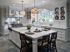 White kitchen with limestone floor