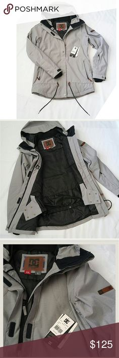 DC snow jacket DC Gray jacket. Tag were taken off accidentally but kept with jacket. It's never been worn.  100% Polyester. Imported Hook and Loop^Snap^Zipper closure Hand Wash10k waterproofing 80 grams body, 40 grams sleeve insulation Critically taped seams Powder skirt, mesh lined venting's, lycra cuff gaiter Media and stash pockets DC Jackets & Coats