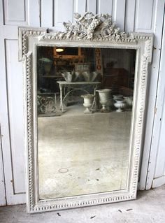 Mirror Reflecting Old World Architectural Elements