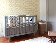 Just in case the Ouef crib and contemporary color scheme didn't already make you feel like you were in a modern art museum, check out the super hip accent wall. Gray and yellow is a trendy color combo and works well for a gender-neutral room.