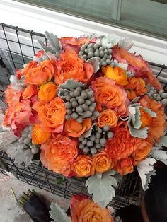 Pewter, orange and unique. Contact Marion at Bayview Florist Wedding Studio in Sayville, NY. Maz851@aol.com