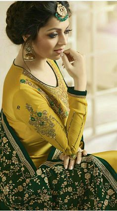 Mustard Churidar Suit is Long sleeve Drashti Dhami Churidar Suit worn by Drashti Dhami with Zari and Resham Work Embroidery. Latest Punjabi Suits Design, Designer Punjabi Suits Patiala, Punjabi Suits Designer Boutique, Latest Salwar Suit Designs, Indian Designer Suits, Salwar Designs, Kurti Designs Party Wear, Blouse Designs, Salwar Suits Party Wear